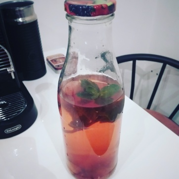 Vegan week: berry ice tea with lemon and mint leaves